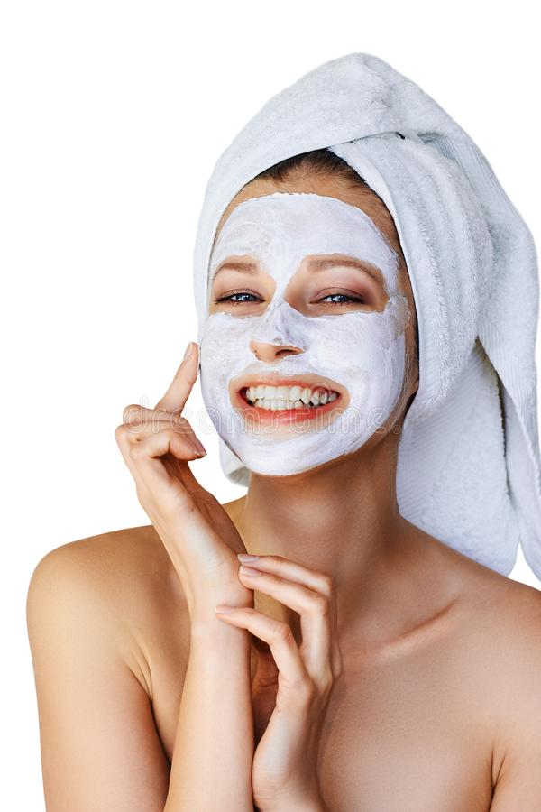 Beautiful young woman applying facial mask on her face. Skin care and treatment, spa, natural beauty and cosmetology concept, stock photos