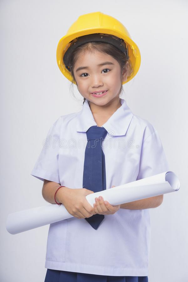 A beautiful young woman architect works in the workplace stock images