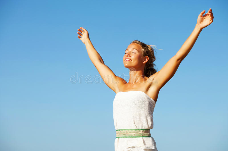 Beautiful young woman with arms raised royalty free stock images