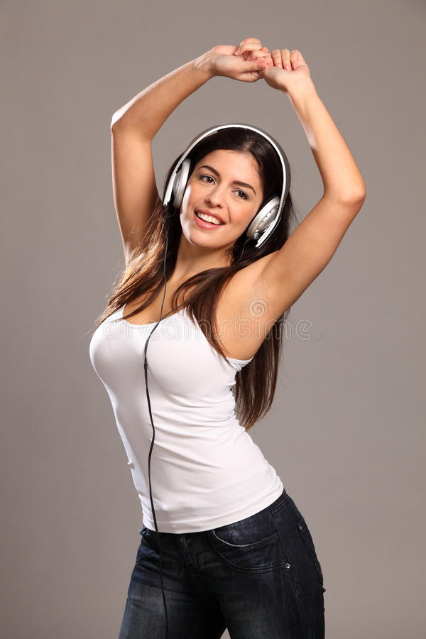 Download Beautiful Young Woman Arms Raised Dancing To Music Royalty Free Stock Image - Image: 17489126