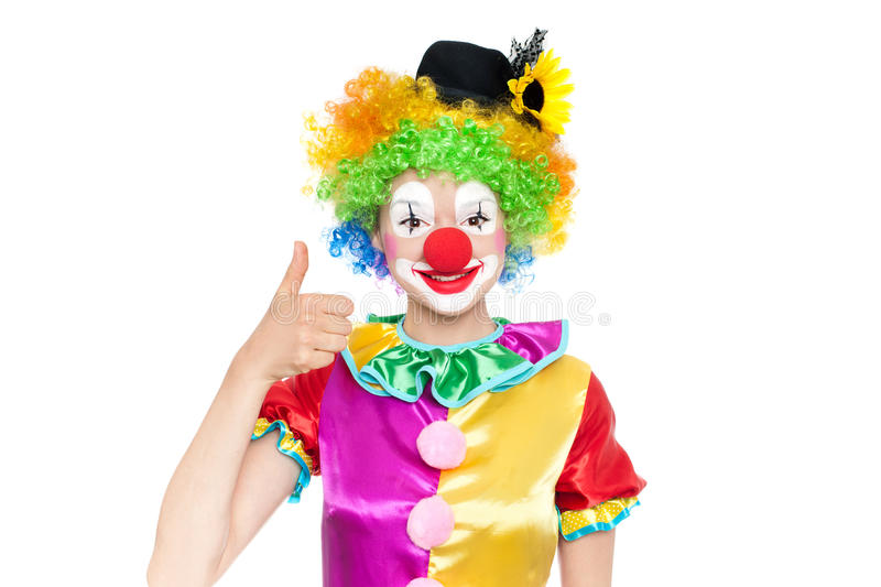 Beautiful young woman as clown royalty free stock image
