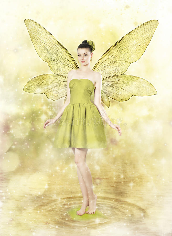 Beautiful young woman as spring fairy royalty free stock image