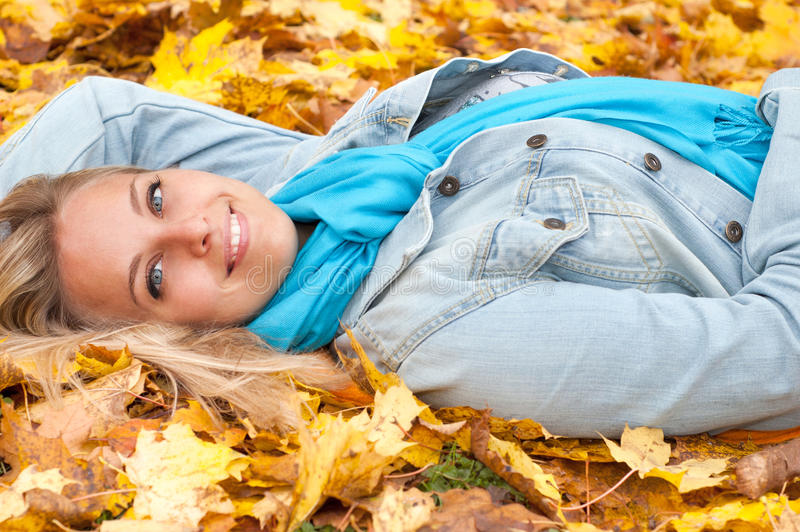 Beautiful young woman in autumn forest royalty free stock image