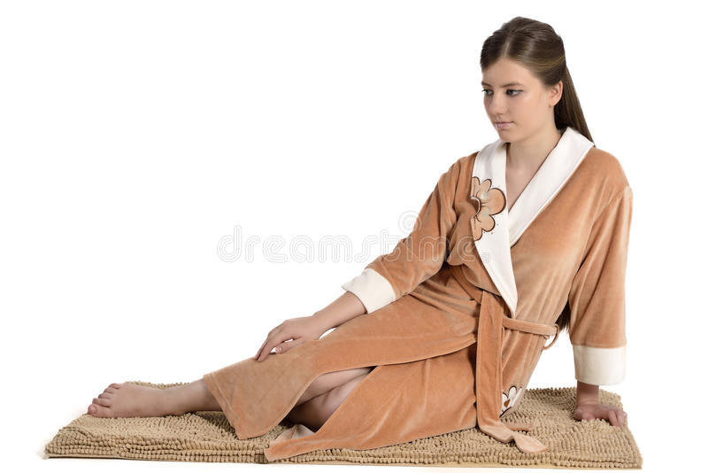 Beautiful young woman in bathrobe royalty free stock photos