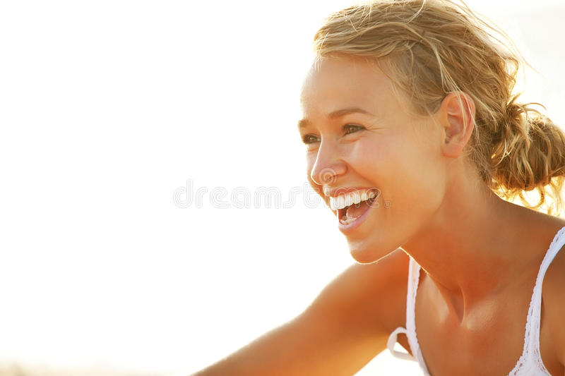 Beautiful young woman on the beach royalty free stock photos