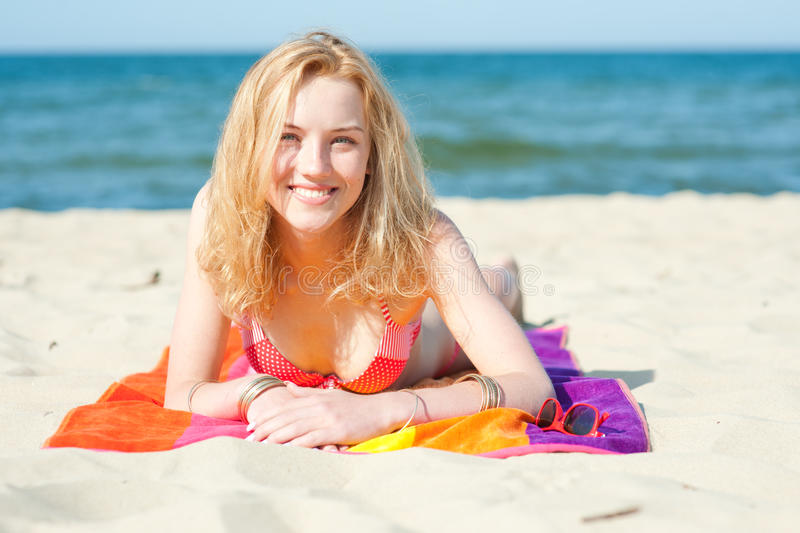 Beautiful young woman on a beach. Summer portrait royalty free stock image
