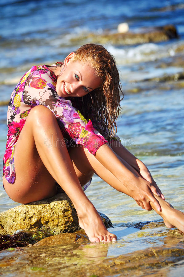 The Beautiful Young Woman On A Beach In A Wet Dres Royalty Free Stock Photo