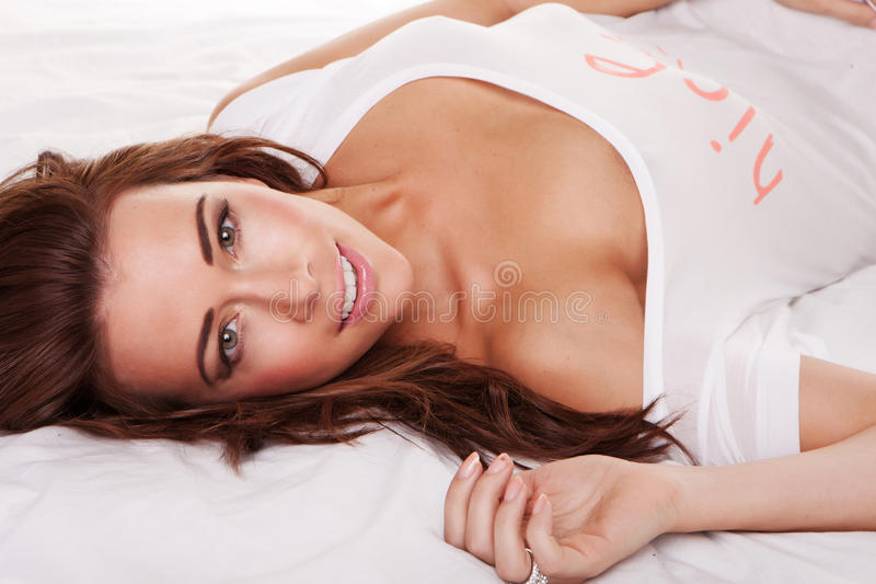 Download Beautiful Young Woman On Bed Stock Image - Image of happy, back: 22624903