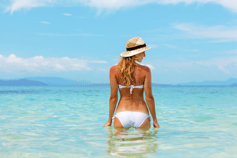 Download Beautiful Young Woman In Bikini On The Sunny Tropical Beach Stock Photo - Image of blue, caucasian: 28687308