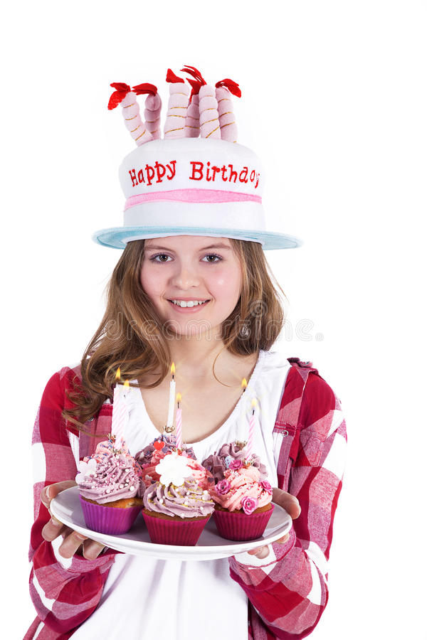 Beautiful young woman with birthday hat. And cup cake royalty free stock image