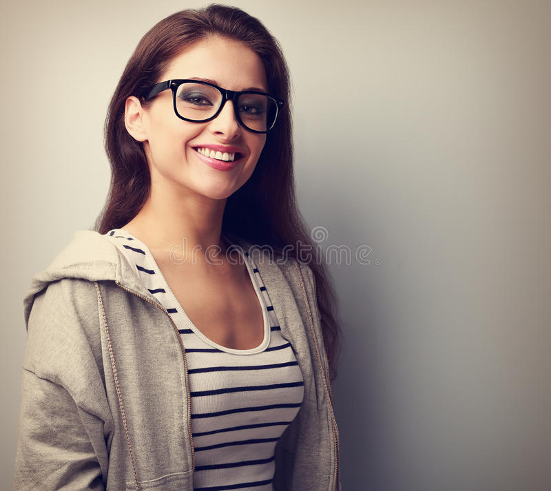 Beautiful young woman in black glasses with toothy smile. Vintage portrait royalty free stock image