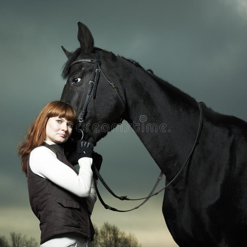 Download Beautiful Young Woman With A Black Horse Stock Images - Image: 16988844