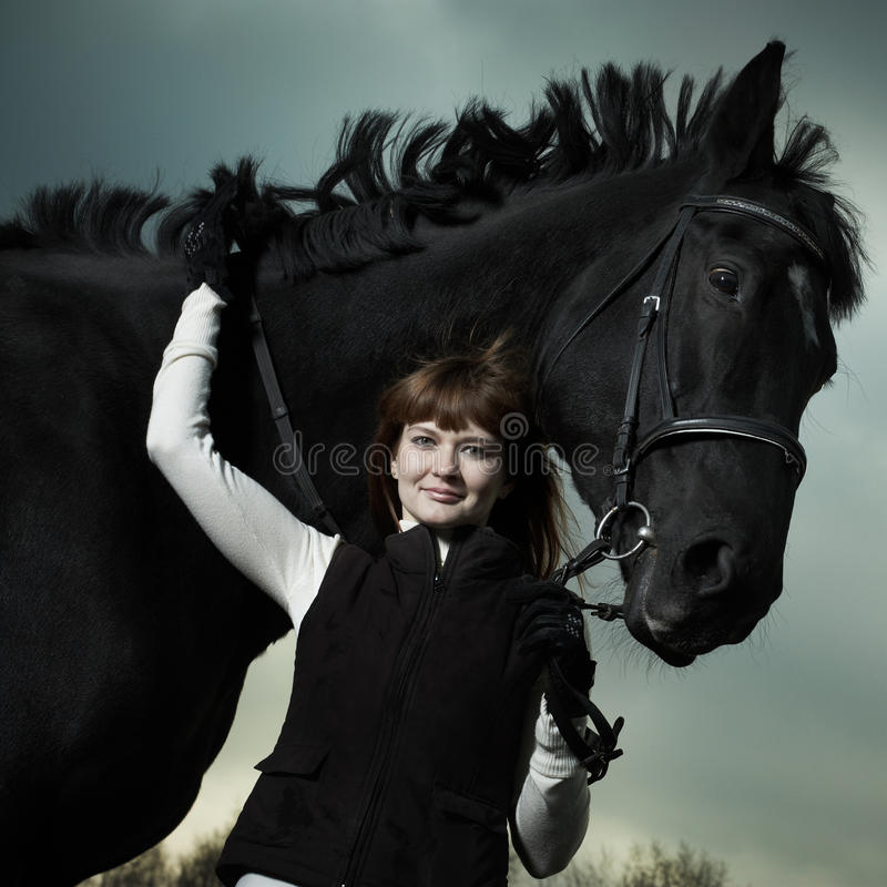 Download Beautiful Young Woman With A Black Horse Stock Photography - Image: 16988892