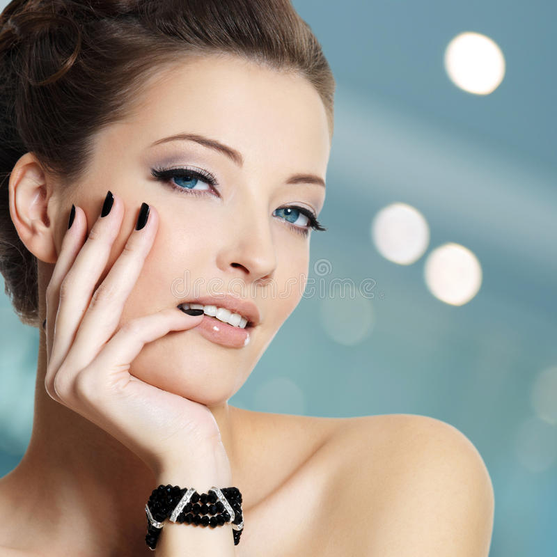 Beautiful young woman with black nails royalty free stock photo
