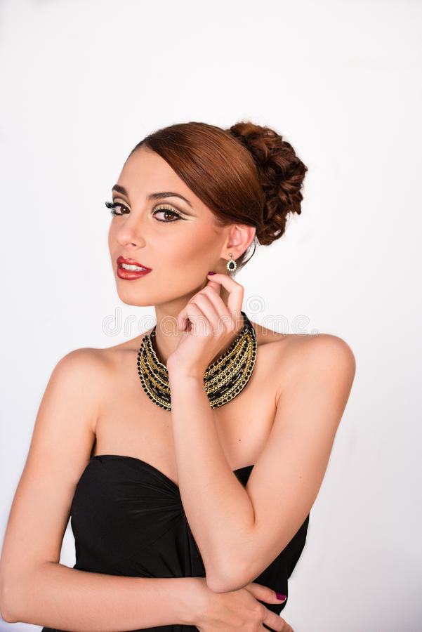 Beautiful young woman with black top and glam make-up royalty free stock photos