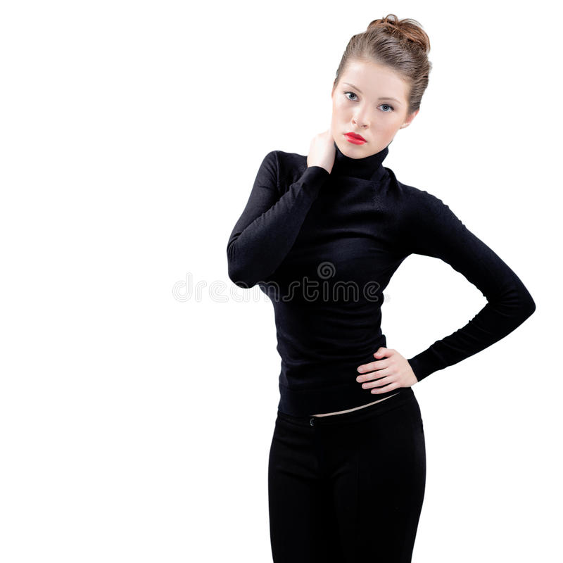 Beautiful young woman in black royalty free stock photo