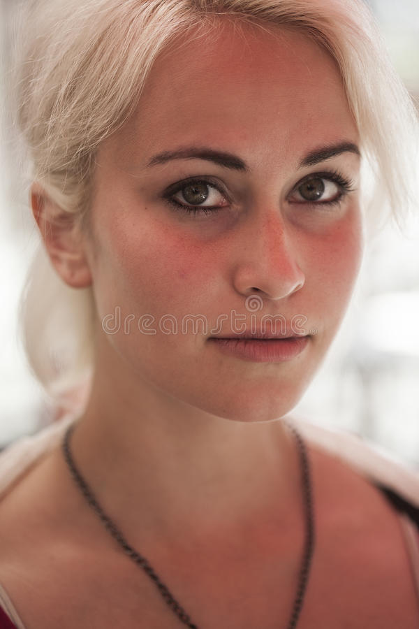 Beautiful Young Woman with Blond Hair and Green Eyes royalty free stock images