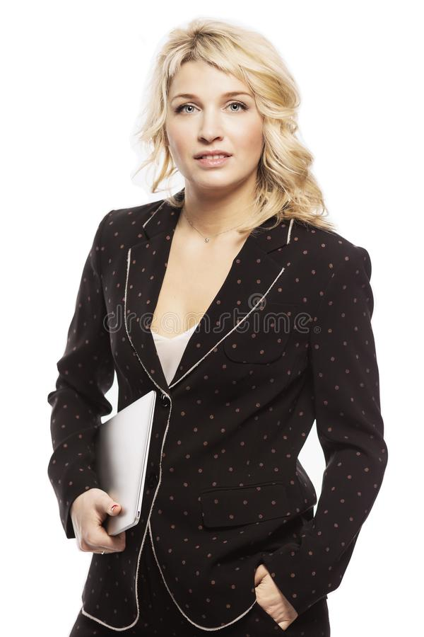 Beautiful young woman, blonde, in a business suit with a laptop royalty free stock photos