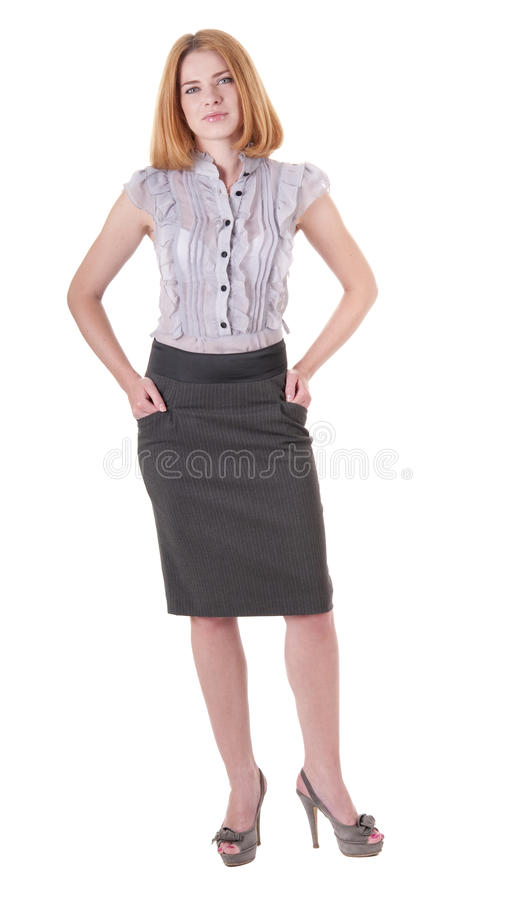 Beautiful young woman in blouse and skirt on white royalty free stock image