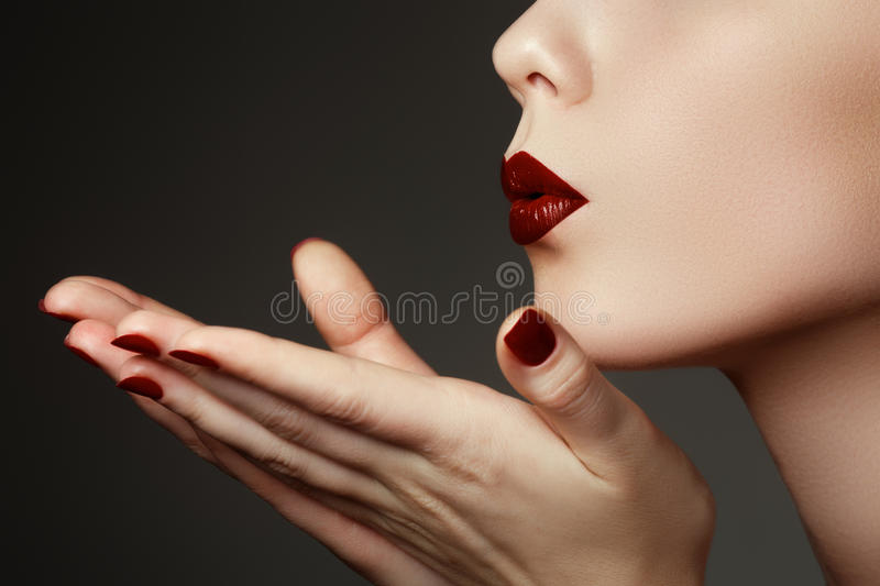 Beautiful young woman blowing a kiss from her hand. Model with p stock photos