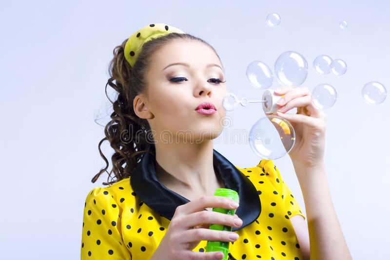 Download Beautiful Young Woman Blowing Soap Bubbles Stock Images - Image: 14050074