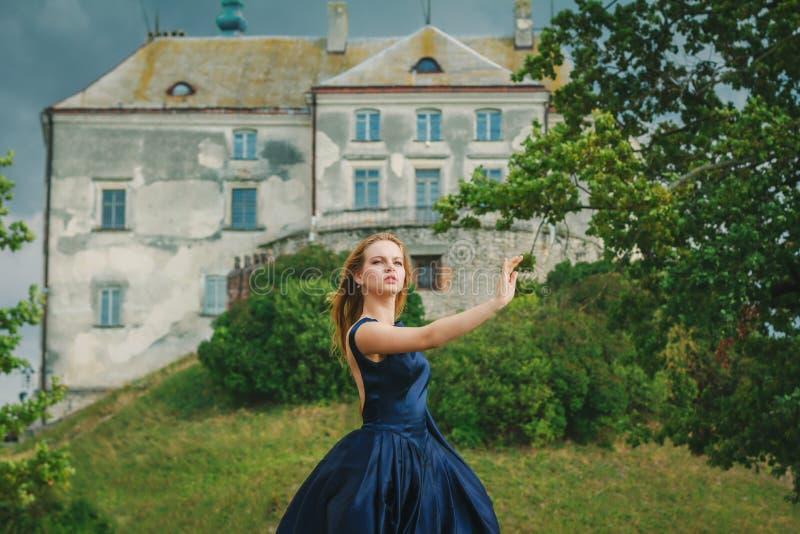 Beautiful young woman in blue dress stock photo
