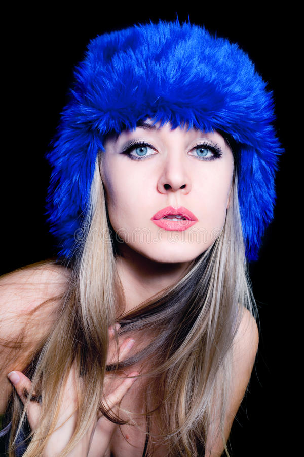 Download Beautiful Young Woman In Blue Winter Hat Stock Photo - Image: 18105390