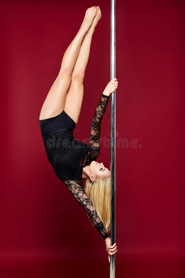 Beautiful pole dancer girl royalty free stock photo