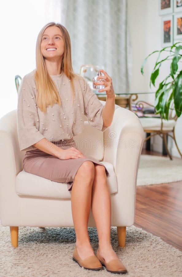 Beautiful young woman with bottle of perfume stock images