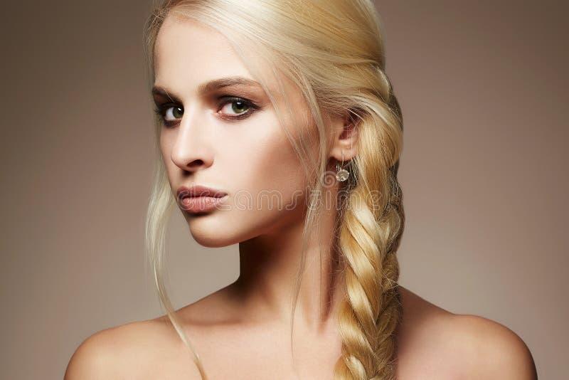 Blond girl with healthy hair stock photos