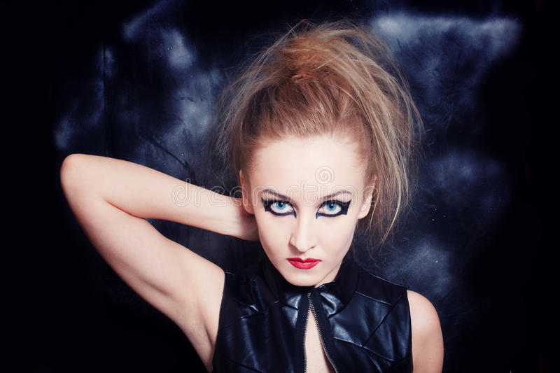 Beautiful young woman with bright Gothic makeup. Portrait of beautiful young woman with bright Gothic makeup closeup royalty free stock images