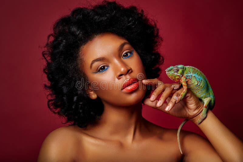 Beautiful woman holding chameleon royalty free stock photos