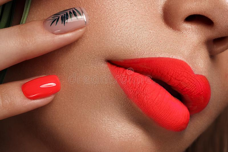 Beautiful young woman with bright makeup and neon pink nails. Beauty face. Photo taken in the studio.  royalty free stock photos