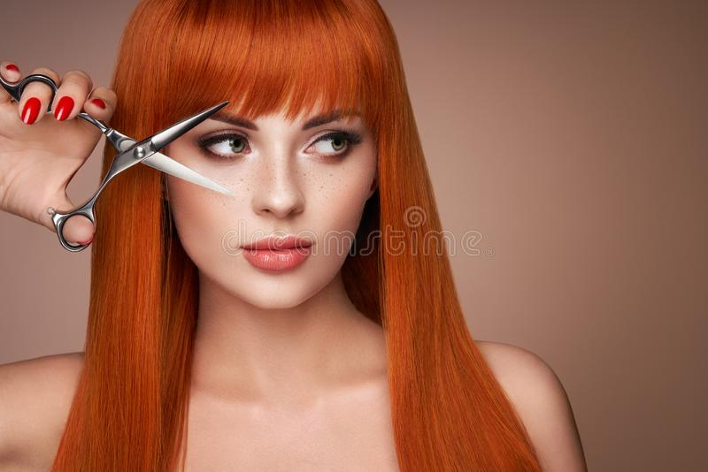 Beautiful young woman with a scissors stock images