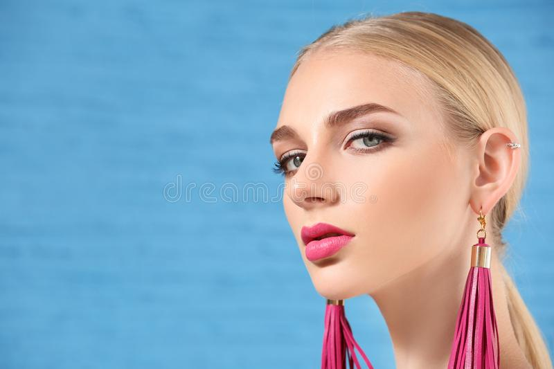 Beautiful young woman with bright pink lipstick on color background stock photo
