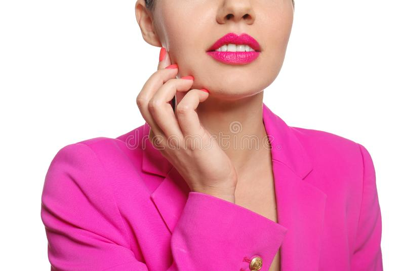 Beautiful young woman with bright pink lipstick on white background, closeup stock images