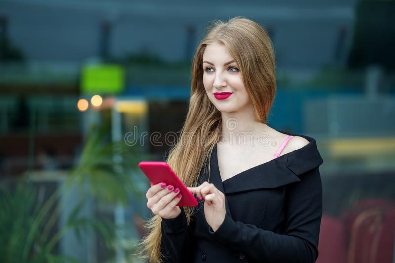 A beautiful young woman is browsing the e-mail. The concept of the Internet, technology, business, communication and lifestyle stock image