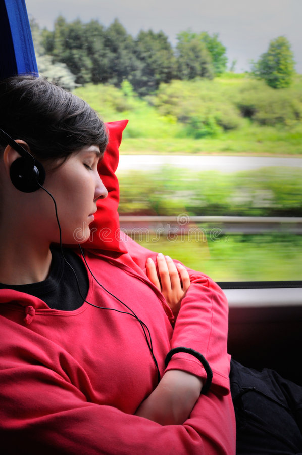 Beautiful young woman in a bus stock photos