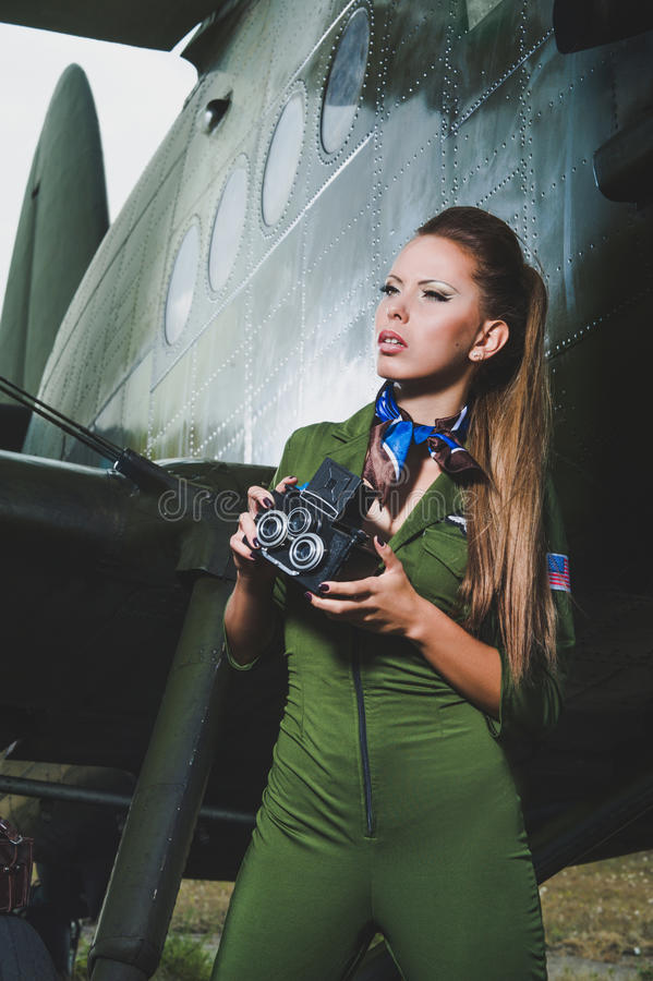 Beautiful young woman with a camera royalty free stock image