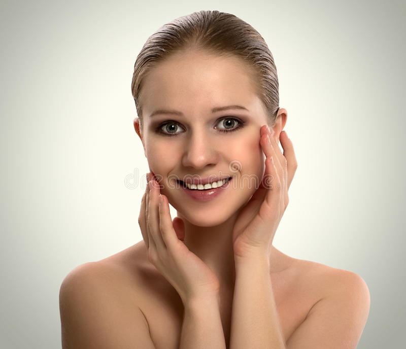 Beautiful young woman cares for skin