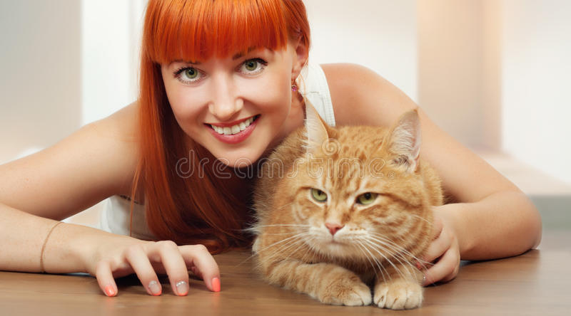 Beautiful young woman with cat stock photography