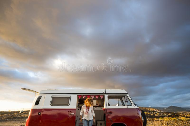Beautiful young woman caucasian in leisure activity with a old van in vacation royalty free stock photos