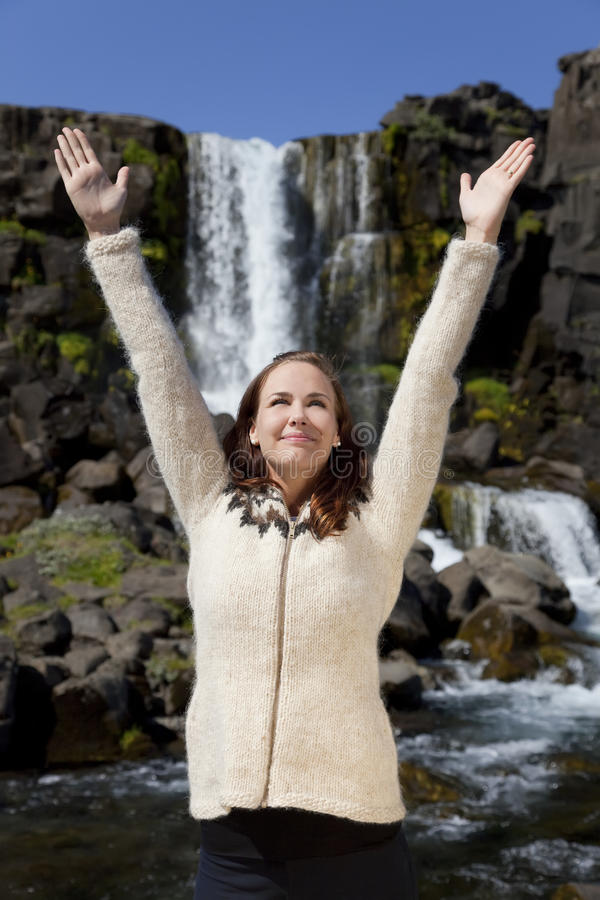 Download Beautiful Young Woman Celebrating By A Waterfall Stock Photo - Image: 12588680