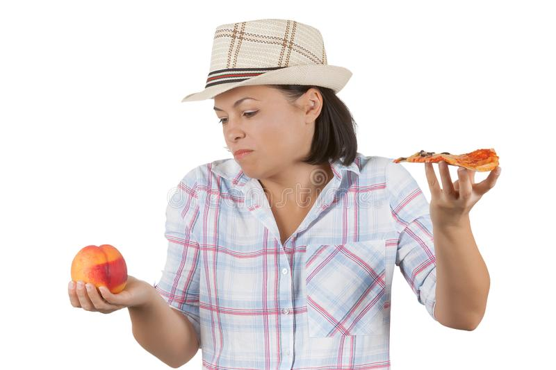 Beautiful Young Woman Choosing a Slice of Pizza or Fresh Peach stock photos
