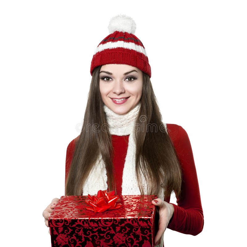 Beautiful young woman with christmas gift on white bacground royalty free stock photography
