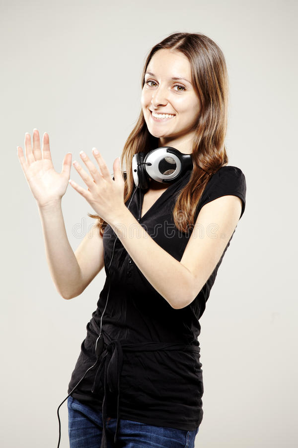 Download Beautiful Young Woman Clapping And Smiling Stock Photo - Image: 27154928