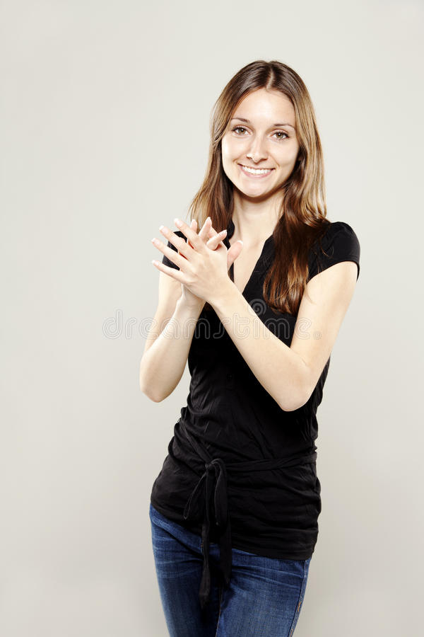 Beautiful young woman clapping and smiling
