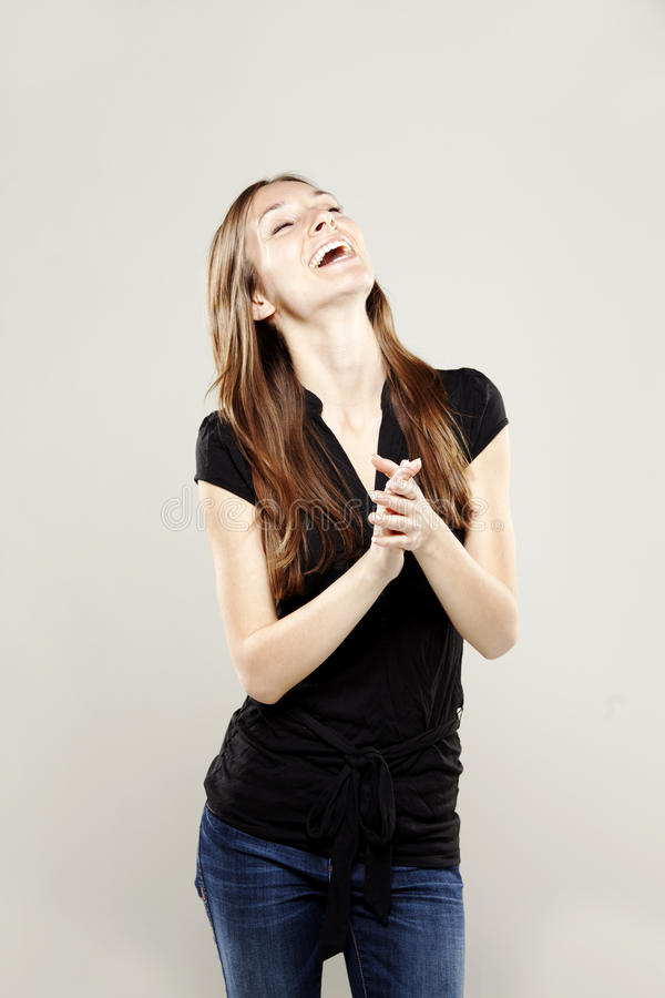 Download Beautiful Young Woman Clapping And Smiling Stock Photo - Image: 27154950