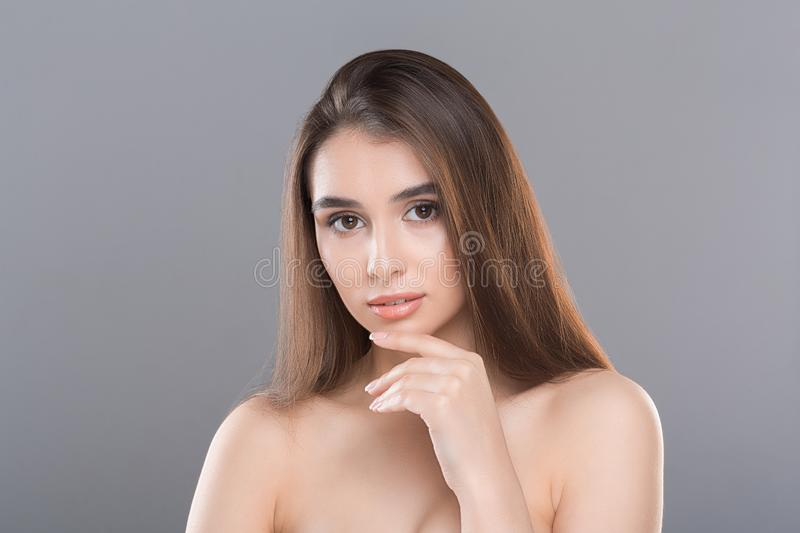 Beautiful Young Woman with Clean Fresh Skin. Girl beauty face care concept stock photos