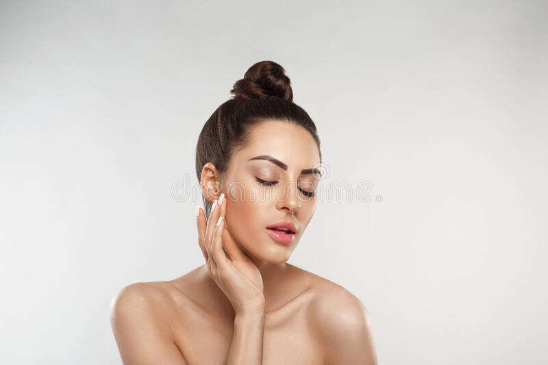 Beautiful Young Woman with Clean Fresh Skin.Girl beauty face. Facial treatment. Skin care. Cosmetology, stock photography